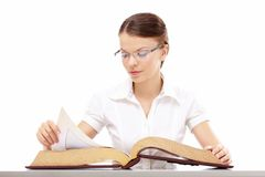Girl with the encyclopaedia Stock Photography
