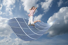 Girl with energy. Solar energy for clean environment Stock Photography