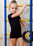 A girl is engaged in acrobatics Royalty Free Stock Images