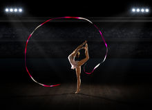 Girl engaged art gymnastic at sports hall Stock Images