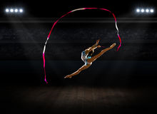 Girl engaged art gymnastic at sports hall Royalty Free Stock Photo