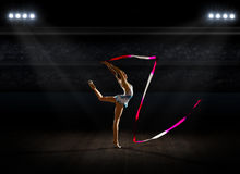 Girl engaged art gymnastic at sports hall Stock Image