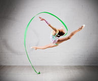 Girl is engaged in art gymnastics Stock Images