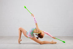 Girl is engaged in art gymnastics Royalty Free Stock Photo