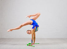 Girl is engaged in art gymnastics Stock Photography
