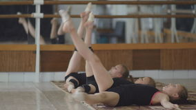 Girl engaged in artistic gymnastics at the gym stock video