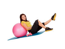 Girl engaged on the ball in the gym Stock Images
