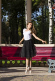 Girl is engaged in a ballet. In the park Stock Photography