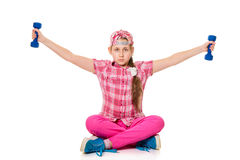 Girl is engaged with dumbbells Royalty Free Stock Images