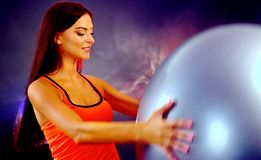 Girl engaged in fitball sport activity. Girl engaged in fitball. Young woman do sport aerobics activity with sport stock photo