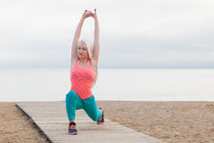 The girl is engaged in fitness on the beach. The girl is engaged in fitness and yoga on the beach Royalty Free Stock Image