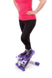 The girl is engaged in fitness stepper. Royalty Free Stock Images