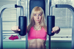 The girl is engaged in the gym Royalty Free Stock Images