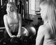The girl is engaged in the gym Royalty Free Stock Photos
