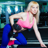 The girl is engaged in the gym Stock Photography