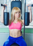 The girl is engaged in the gym Royalty Free Stock Photo