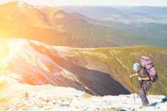 The girl is engaged Hiking in the mountains. Stock Photography