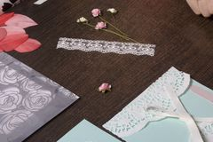 The girl is engaged in making greeting cards at home. Using paper, lace, braid and other materials. The girl is engaged in making greeting cards at home. Using Stock Photo