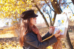 The girl is engaged in painting Royalty Free Stock Images