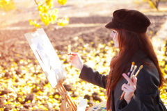 The girl is engaged in painting Stock Image