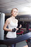 Girl is engaged in a sports hall Royalty Free Stock Images
