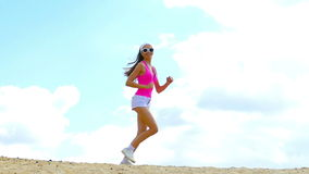 Girl is engaged in sports jogging Stock Images