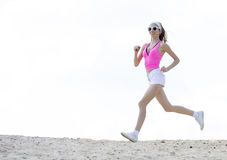 Girl is engaged in sports jogging Royalty Free Stock Images