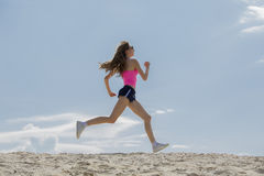 Girl is engaged in sports jogging Stock Photo