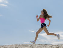 Girl is engaged in sports jogging Royalty Free Stock Photography
