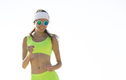 Girl is engaged in sports jogging Stock Photos