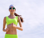 Girl is engaged in sports jogging Royalty Free Stock Photo