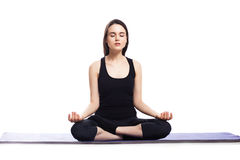 Girl is engaged in yoga on a white background, concept of health. Girl is engaged in yoga on white background, concept of health Royalty Free Stock Image