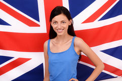 Girl with England flag in the background smiling. Stock Image