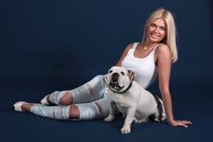 The girl with an English bulldog Royalty Free Stock Photos