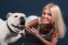 The girl with an English bulldog Stock Images