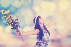 Girl enjoy freedom with festive light background Royalty Free Stock Photos