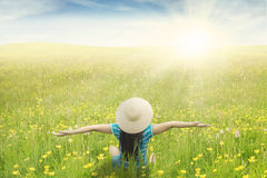 Girl enjoy holiday at the blossom meadow Royalty Free Stock Photo