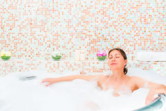 Girl enjoy Jacuzzi in a romantic atmosphere Stock Photography