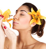 Girl enjoy lily flower smell Royalty Free Stock Photos