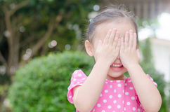 Girl enjoy playing hide and seek outdoor Stock Photography