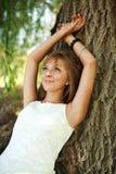 Girl enjoy summer day under the tree Stock Photo