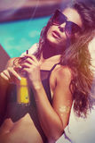 Girl enjoy in sun and juice at pool hot summer day. Attractive girl in bikini and sunglasses enjoy in sun and juice at pool hot summer day Royalty Free Stock Photography