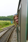 Girl enjoy travel by train Stock Images