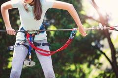 Girl enjoying activity in a climbing adventure park Stock Photography