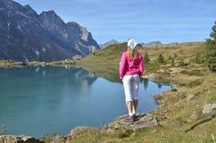 Girl enjoying Alpine panorama Stock Images