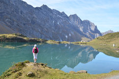 Girl enjoying Alpine panorama. Switzerland Royalty Free Stock Images