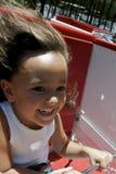 Girl enjoying amusement ride Stock Images