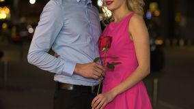 Girl enjoying aroma of beautiful rose, present from boyfriend on date, romance. Stock footage stock video