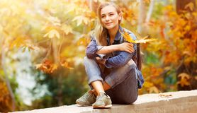 Girl enjoying autumn Stock Photos