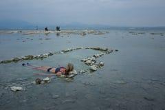 Girl enjoying a bath in the sulfur royalty free stock image